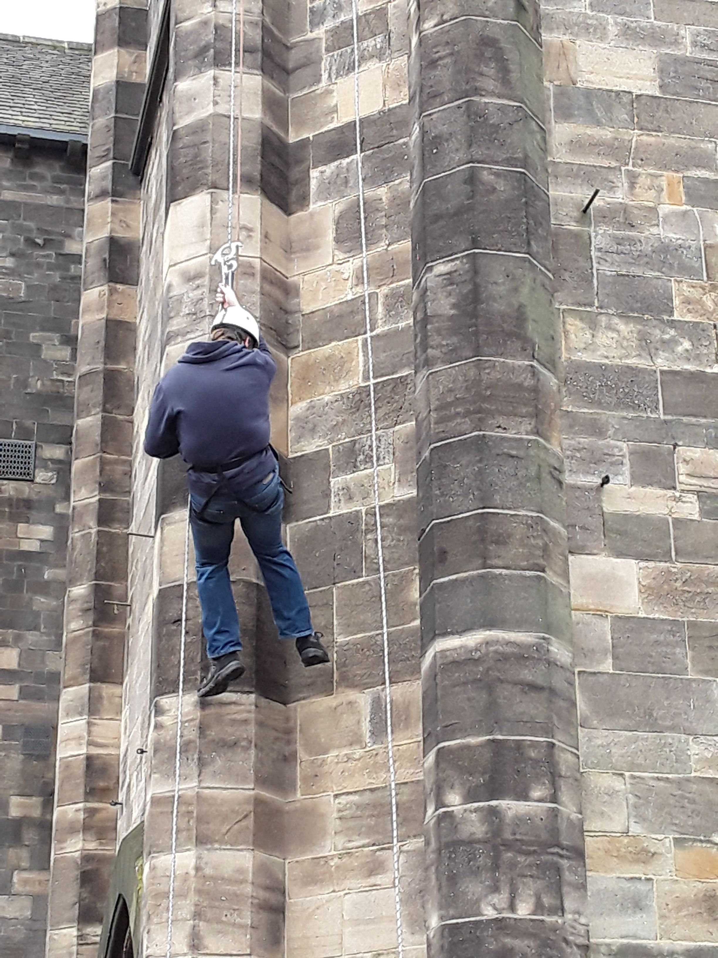 THEY DID IT!!!!!!!! Rochdale Town Hall's clock face abseil